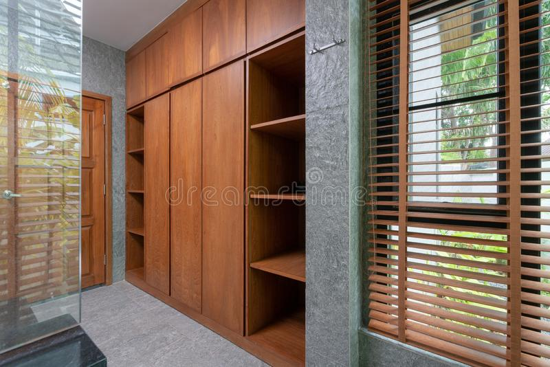 Wooden built in wardrobe in the house stock image